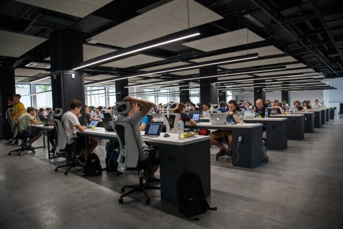 Employees working in an open floor office