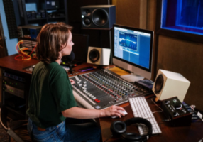 a woman playing audio mixer after soundproofing her windows